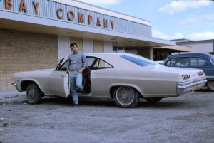 cool inco guy with car side view 1965