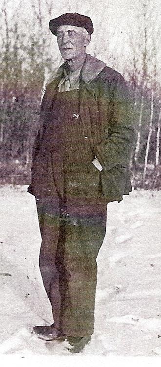 Ole J. Statland standing in snow 1927